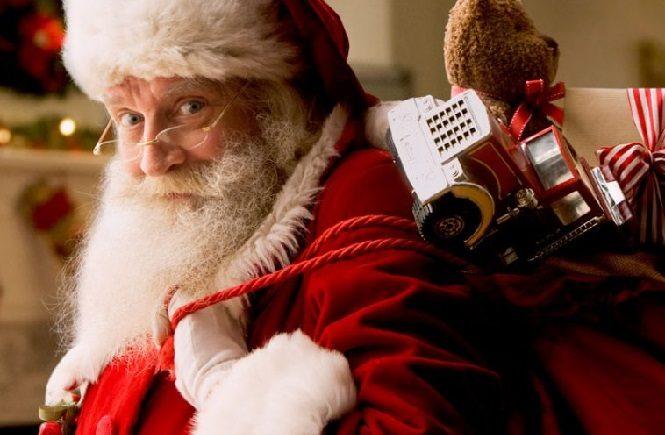 Санта Клаус с мешком детских подарков